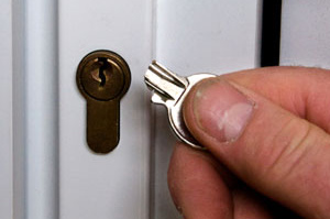 Lock changes in Colchester. Colchester Locksmith changing a lock.
